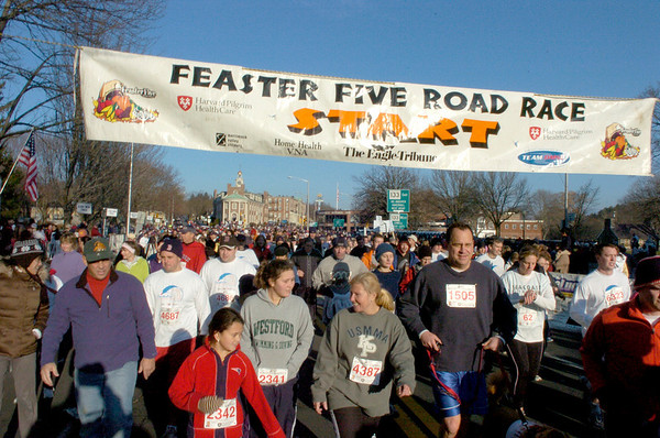 Andover: A large crowd of runners take part in the 21st Annual Feaster Five Road Race in Andover Thanksgiving morning. Photo by Tim Jean/Eagle-Tribune Thursday, November 27, 2008