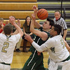 Record-Eagle photo/Jan-Michael Stump<br /> Traverse City West's KJ Sayer (2) and Tshiyombu Lukusa (55) defend Alpena's Tyler Pintar (5) in the third quarter of Tuesday's game.