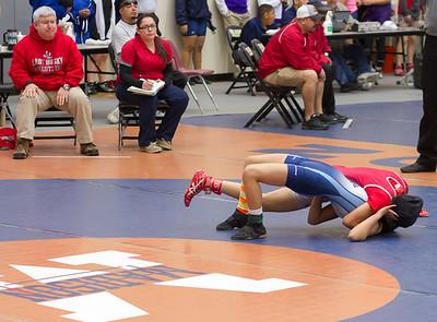 Stephanie Escobedo of Juarez Lincoln pins Emma Salazar of McAllen on Saturday in the 165 pound class.