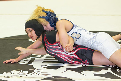Alyssa Salinas of Palmview was defeated by Anna Becera of Austin Akins in the 102 pound class during the final day of the UIL Region 4-6A Wrestling Tournament in san Antonio on Saturday, February 14th, 2015. PAUL BRICK FOR PROGRESS TIMES.