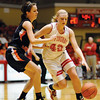 Effingham's Stephanie Robb dribbles around Olney's Sadie Gassman in the Hearts' win over the Lady Tigers at the Centralia Regional.