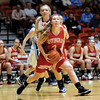 Effingham's Jantzen Michael drives in for two of her team-high 12 points in Centralia Regional championship.