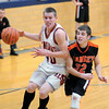 Altamont's Jon Kuhns drives in for a fast-break layup in the Indians' win against Ramsey at the St. Elmo Regional.