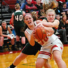 Effingham's Lauren Stephenson battles for possession of the ball with a player from Salem.