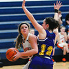 Altamont's Macy Wendling looks to the basket while being guarded by Brownstown/St. Elmo's Danie Austin.