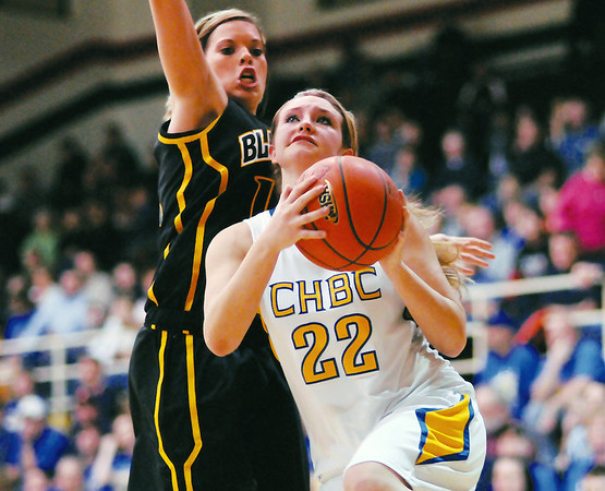 CHBC's Autumn Riley takes the ball to the basket while Goreville's Alison Webb defends from behind in the Salem Super-Sectional.