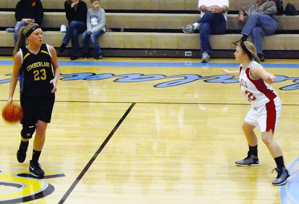 Cumberland's TIffany Shull brings the ball up the court while Vandalia's Amber Bruno sets the Lady Vandal defense