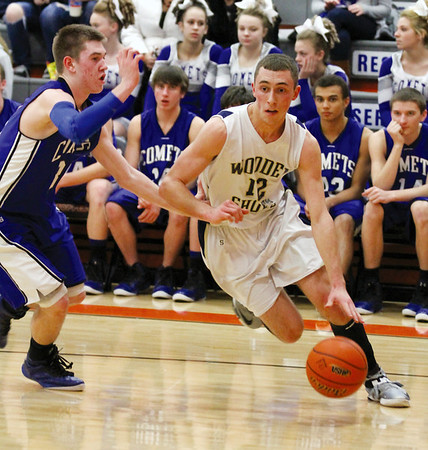 Teutopolis' Jared Waldhoff drives past Greenville's Austin Lawrence in the Shoes' win in Hillsboro.