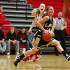 Teutopolis' Danielle Repking leaps past St. Anthony's Megan Nuxoll at the Enlow Center in Effingham in December. The Lady Shoes enter today's super-sectional as the underdogs against the Nashville Lady Hornets.