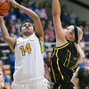 CHBC's Micah Jones goes for a layup against Goreville's Alison Webb. Both Jones and Webb made the AP 1-A All-State team.