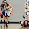 Teutopolis' Cierra Thompson dribbles away from Greenville's Maria Reinhard after a steal in the third quarter.
