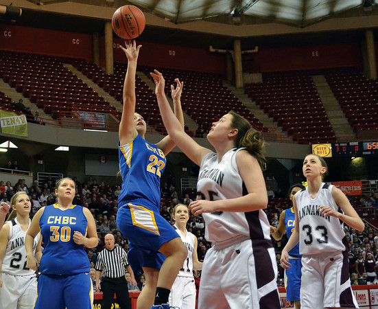 CHBC's Autumn Riley puts a layup over the defense of Annawan's Celina VanHyfte.