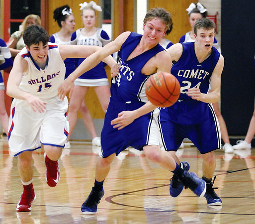 St. Anthony senior Jacob Schuette fights for position with Greenville junior Devon Leitschuh for a loose ball in the first half of the Comets' win over the Bulldogs at Hillsboro.
