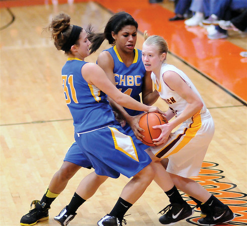 Dieterich's Courtney Flach is pressured defensively by CHBC's Kacie Hilt (left, 31) and Micah Jones (14, center) at Altamont High School.