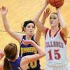 St. Anthony's Maggie Mumm takes a jump shot while being guarded by Brownstown/St. Elmo's Molly Hill (20, background) and Bethany Oberlink (front).