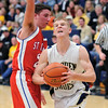Teutopolis' Derek Smith drives past St. Anthony's Charlie Schultz.