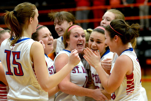 Lexie Niebrugge (center) embraces Makayla Walsh to her right as the St. Anthony Lady Bulldogs celebrated their Altamont Regional championship win over Altamont.
