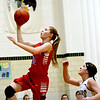 St. Anthony's Kate Richards rises up for a layup in front of Brownstown/St. Elmo's Molly Hill in Brownstown. St. Anthony clinched the NTC with the win.