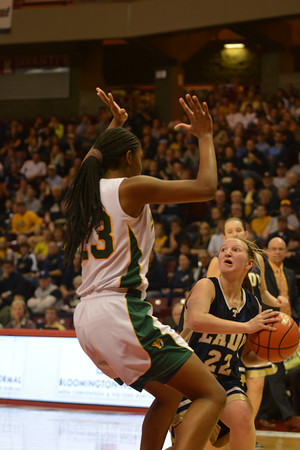 Teutopolis' Danielle Repking pulls up and looks for an option while being guarded by Champaign St. Thomas More's Tori McCoy during the Class 2A state semifinal.