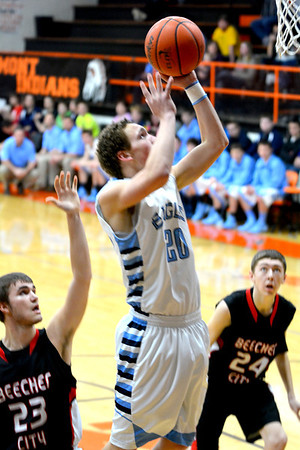 St. Elmo/Brownstown's Levi Maxey takes a layup against Beecher City.
