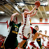 Effingham's Phil Knight blows by the defense of Mattoon's Tanner Scott for a layup.