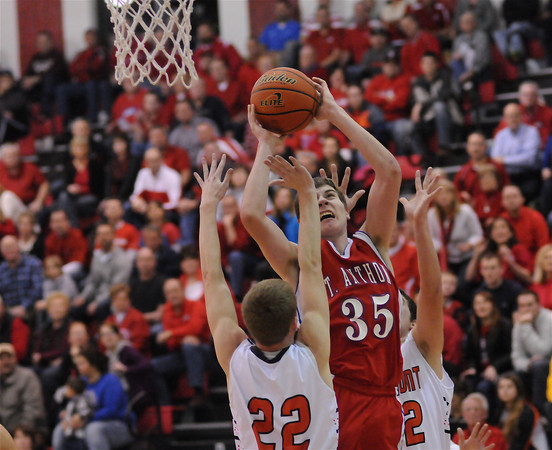 St. Anthony's Alex Hoelscher shoots while being double teamed by a pair of Altamont defenders, including Cole Borders (22) at the Class 1A Nokomis Regional.