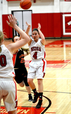 Neoga's Madison Butler throws a pass into the lane toward Jillian Deters against Altamont