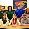 Stew-Stras' Brittani Tabbert signs her letter of intent to play volleyball at Lincoln Land College. She is surrounded by her parents, Karla and Chris Tabbert. In the back row, left to right, stands Stew-Stras athletic director Nick Niemerg, head coach Ronda Schlechte, Lincoln Land head coach Jim Dietz and club head coach Lisa Peifer