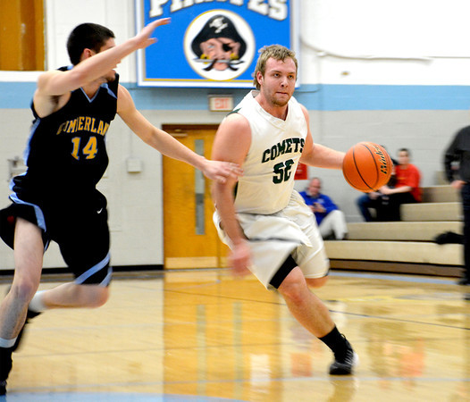 Stew-Stras' Jason Fry dribbles into the lane and around the defense of Cumberland's Caleb Brumleve