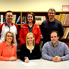 St. Anthony alumna and current Lincoln student Kassy Dammerman signs to play volleyball and run track at Lincoln. With her in the front row are her parents, Amy and Matt Dammerman. Back row, from left: St. Anthony athletic director Kevin Palmer, St. Anthony volleyball coach Kristie Bailey, Lincoln volleyball coach Mark Tippett.