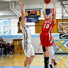 Neoga's Olivia Ott takes a jump shot while an Arcola defender closes in.
