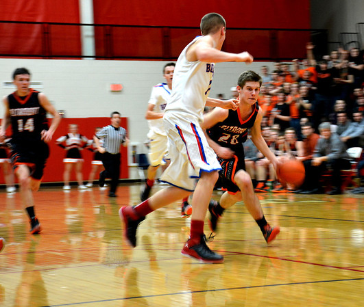 Altamont's Garrett Ziegler takes the ball to the basket while being guarded by St. Anthony's Frank Jansen.