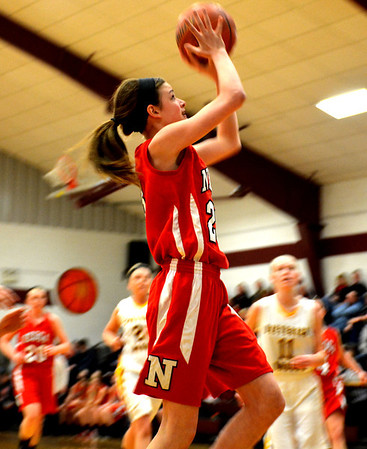 Neoga's Jaycie Roy slashes to the hoop for a layup during the first quarter of the Lady Indians' win over Dieterich.
