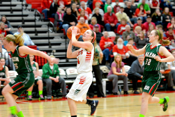 Effingham's Felicia Totten puts up a layup after successfully head-faking Salem's Kyla Cook (left) during the Lady Hearts' Regional championship victory.