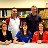St. Anthony's Lauren Wendt signs her letter of intent to play volleyball at Lincoln College. To her left is her mother, Nikki Wendt, and to her right is St. Anthony volleyball coach Kristie Bailey. Back row: St. Anthony athletic director Kevin Palmer, Lincoln volleyball coach Mark Tippett.