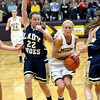 Teutopolis' Haley Giles (left) and Danielle Repking (center) guard Mt. Carmel's Tyra Buss while Cierra Thompson (35, right) gets a hand on the ball during the Class 2A Casey-Westfield Sectional championship game.