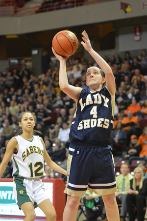Teutopolis' Jessica Schumacher lets a shot go during the Class 2A state semifinal against Champaign St. Thomas More.