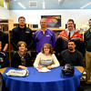 Stew-Stras' Courtney Schultz signs her letter of intent to play softball at Kaskaskia College. She is surrounded by Kaskaskia College head coach Torey Crowell, far bottom left, and her parents, Nola and Brian Schultz, on either side of her. Standing behind her, from the left, is Stew-Stras principal Mark Giertz, club coaches Drew Danalewich and Doug Bell, Stew-Stras head coach Kyle Knop and athletic director Nick Niemerg.