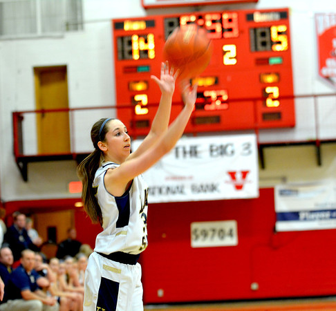 Teutopolis' Cierra Thompson lets a 3-pointer fly off her fingertips in the Lady Shoes' 56-24 win over Vandalia at the Vandalia Regional.