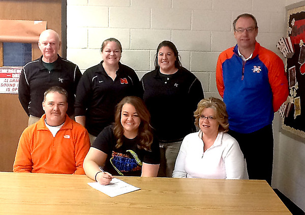 Newton's Karsyn McCoy (front, center) signs her letter of intent to play softball at Lincoln Trail College in Robinson on Jan. 27.