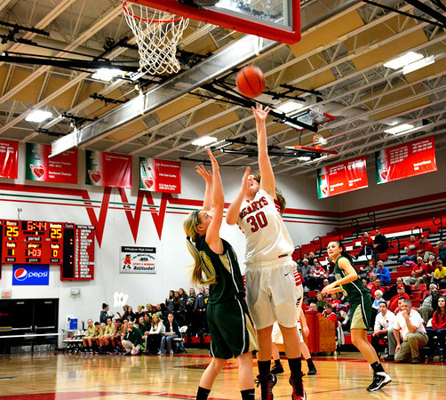 Effingham's Lauren Stephenson puts up a hook shot over the defense of Mattoon's Avery Jackson during the Class 3A Effingham Regional semifinal.