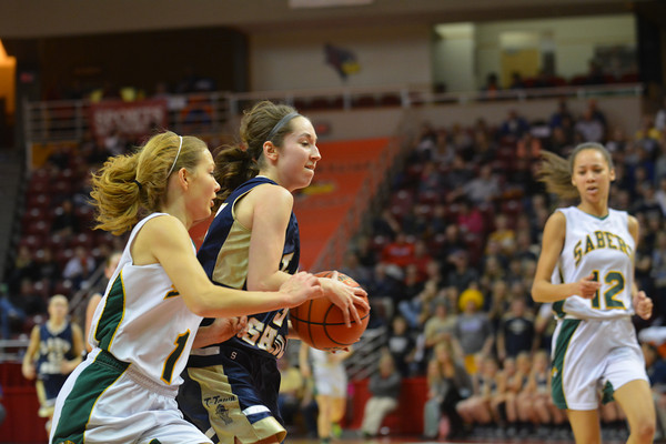 Teutopolis' Cierra Thompson is pressured by Champaign St. Thomas More's Randa Harshbarger at the Class 2A state semifinal.