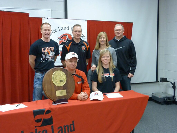 Altamont's Deidre Ledbetter signs her letter of intent to play softball at Lake Land College, with Lake Land coach Nic Nelson sitting to her right. Back row, from left: Coach John Niebrugge, John Ledbetter, Kris Ledbetter, summer coach Wade Bradley.