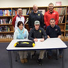 St. Anthony's Austin Bushur signs his letter of intent Thursday to play baseball at Parkland College next season. He is surrounded by his parents, Sheri and Kevin Bushur. Back row, from left: St. Anthony athletic director Kevin Palmer, a Parkland College baseball coach, and St. Anthony baseball coach Kenny Koenig.