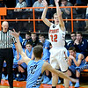 Altamont's Cole Borders fires a 3-pointer over the defense of St. Elmo/Brownstown's Landon Feezel during the Indians' win in Altamont.