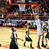 Altamont's Justin McGinnis twists his body for a layup between three Stew-Stras defenders.