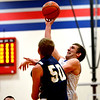 St. Anthony's John Goeckner puts up a hook shot while being guarded by Teutopolis' Brett Mette.