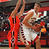 Effingham's Isaac Foreman looks to the basket against Olney's Alec St. Pierre at Effingham High School.