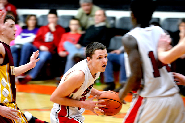 Neoga's Jake Baker drives to the lane shortly after scoring his 1,000th career point against Dieterich.
