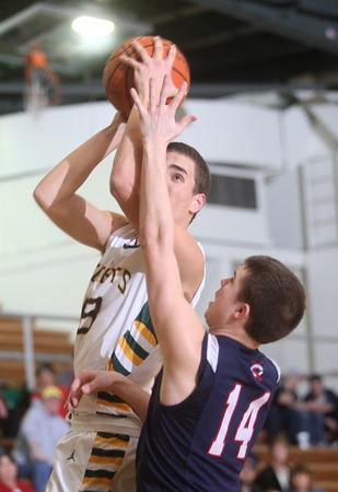 2-12-15<br /> Eastern vs Cass basketball<br /> Eastern's Braden Evans gets fouled by Ryan Bixler at the basket.<br /> Kelly Lafferty Gerber | Kokomo Tribune